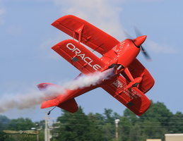 Sean Tucker tumbling over his Oracle Challenger III