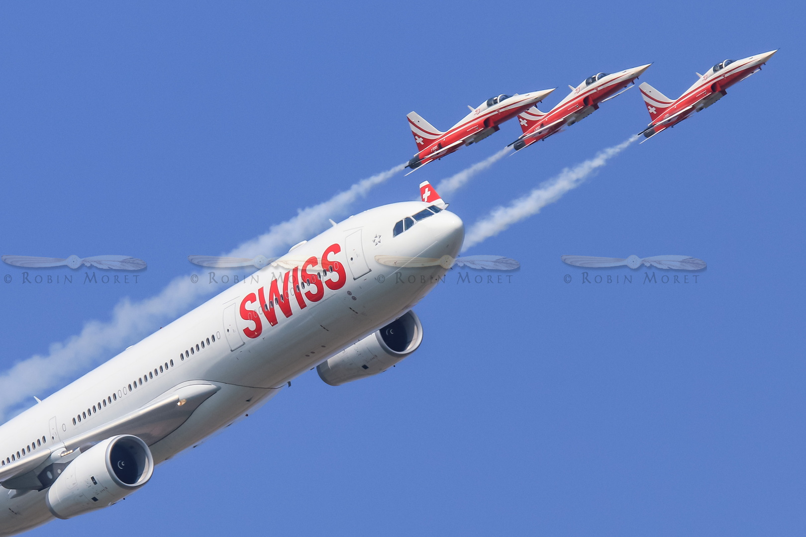 Patrouille Suisse flying along Swiss' A330-300
