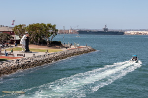 USS Carl Vinson & Embracing Peace statue